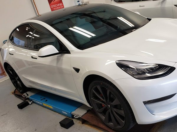 Tesla with window tint, clear bra, ceramic coating and chrome delete.